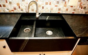 Granite Sink in an Apron Front design provides a modern look.